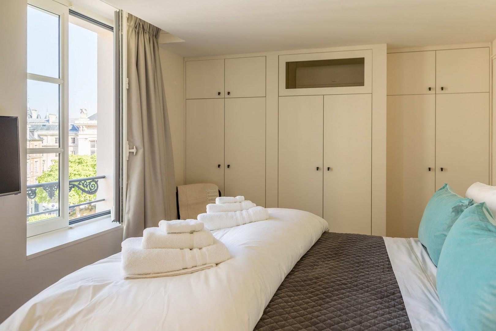 The bedroom overlooks Place Dauphine and has plenty of closets.