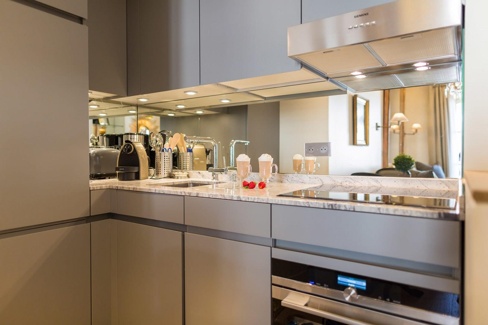 The modern kitchen is equipped with top-of-the-line appliances.