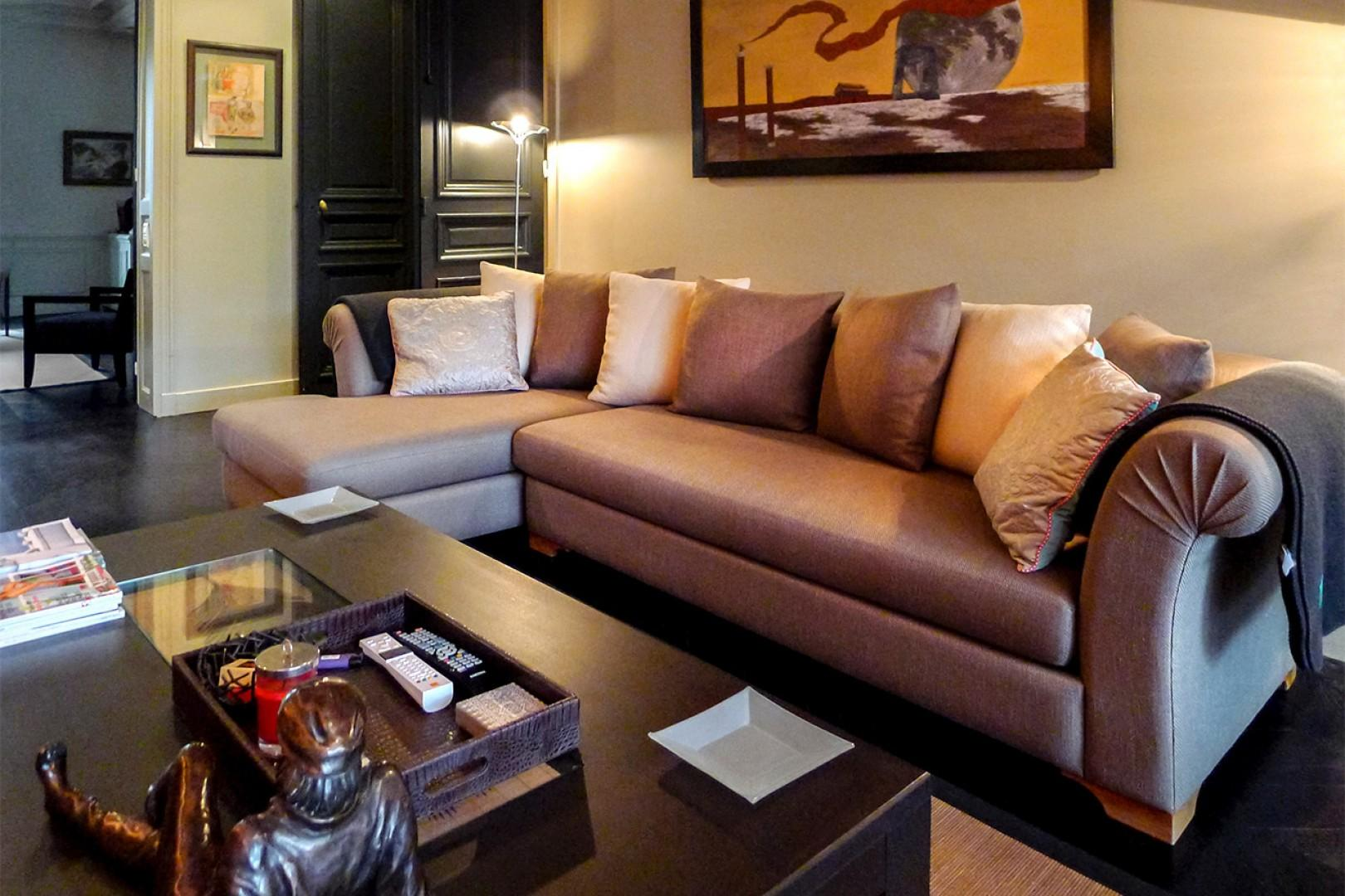 Relax on the comfortable designer sofa in the den.