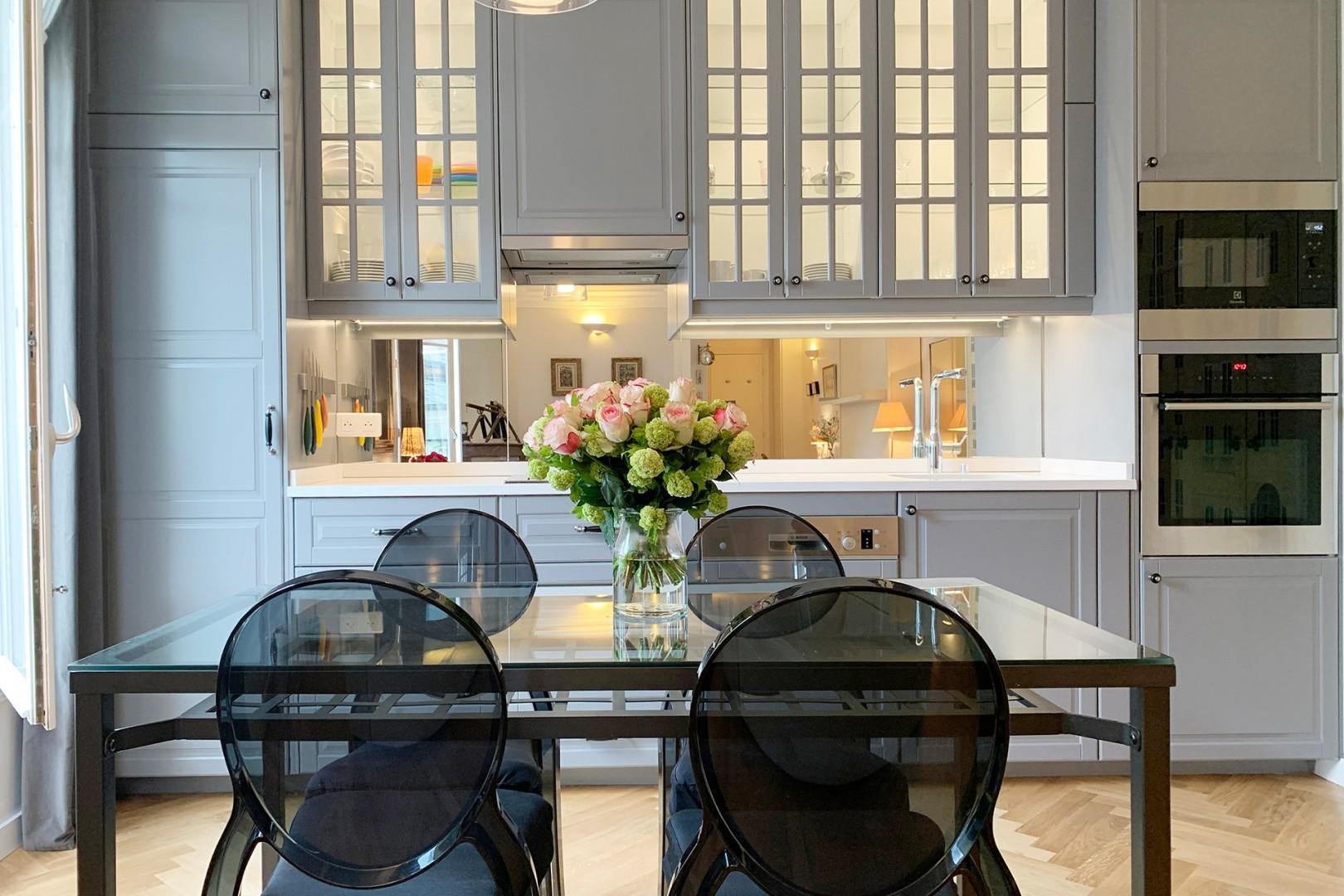The lovely dining table can seat up to 6 guests, perfect for a home-cooked meal.