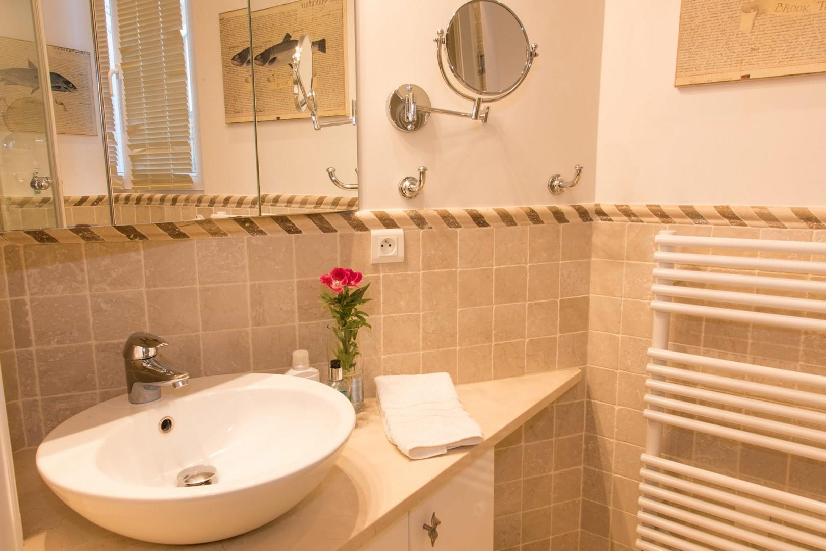Bathroom 2 also features heated towel racks for your comfort.