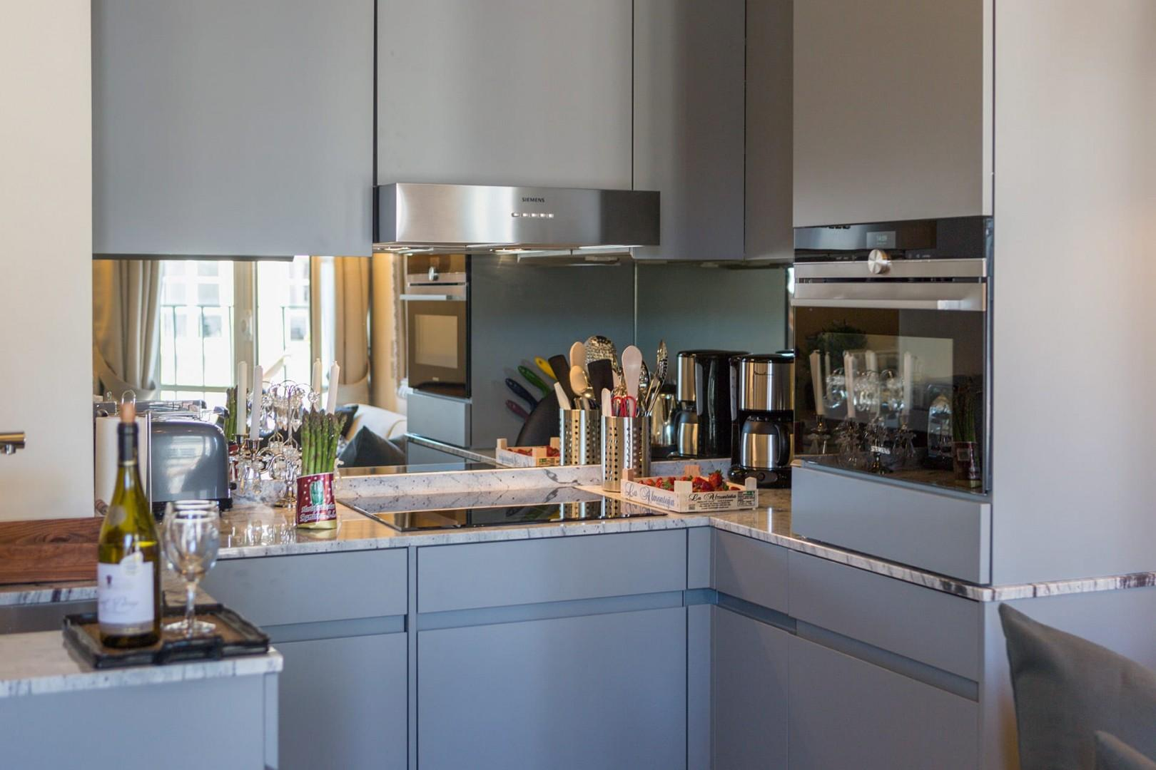 The kitchen features modern appliances for your comfort.