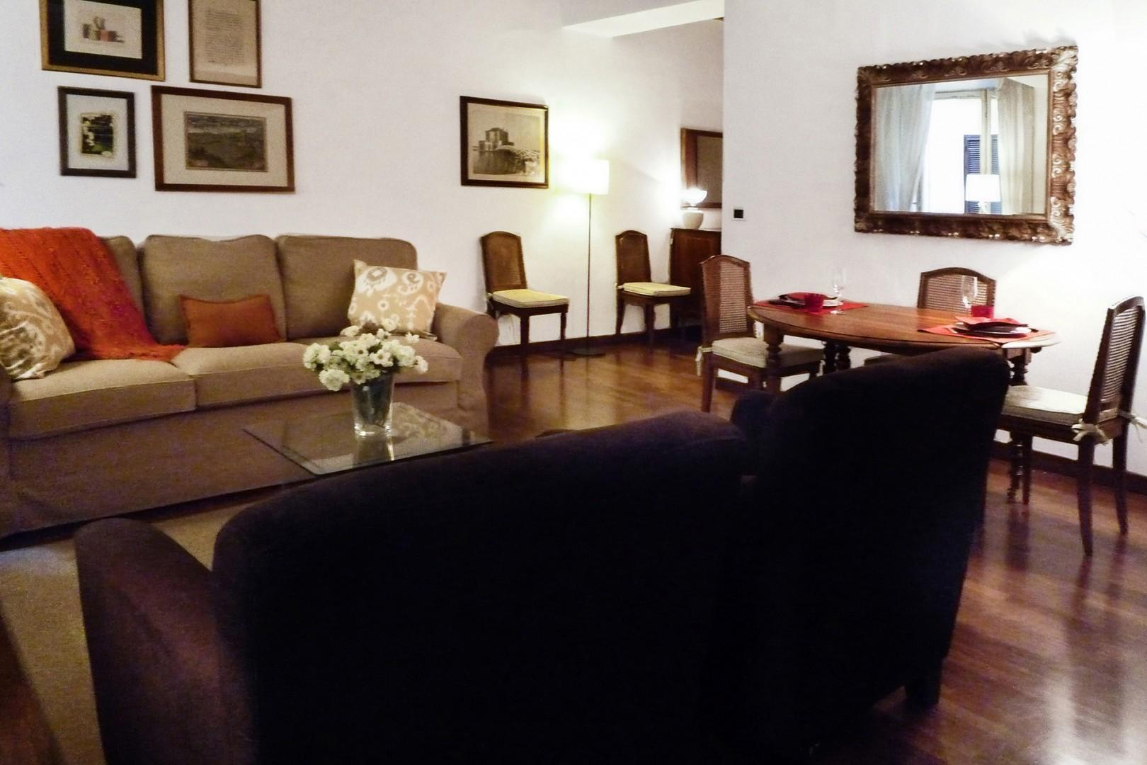 This apartment is a junior one bedroom, seen here just to the left of the dining table.