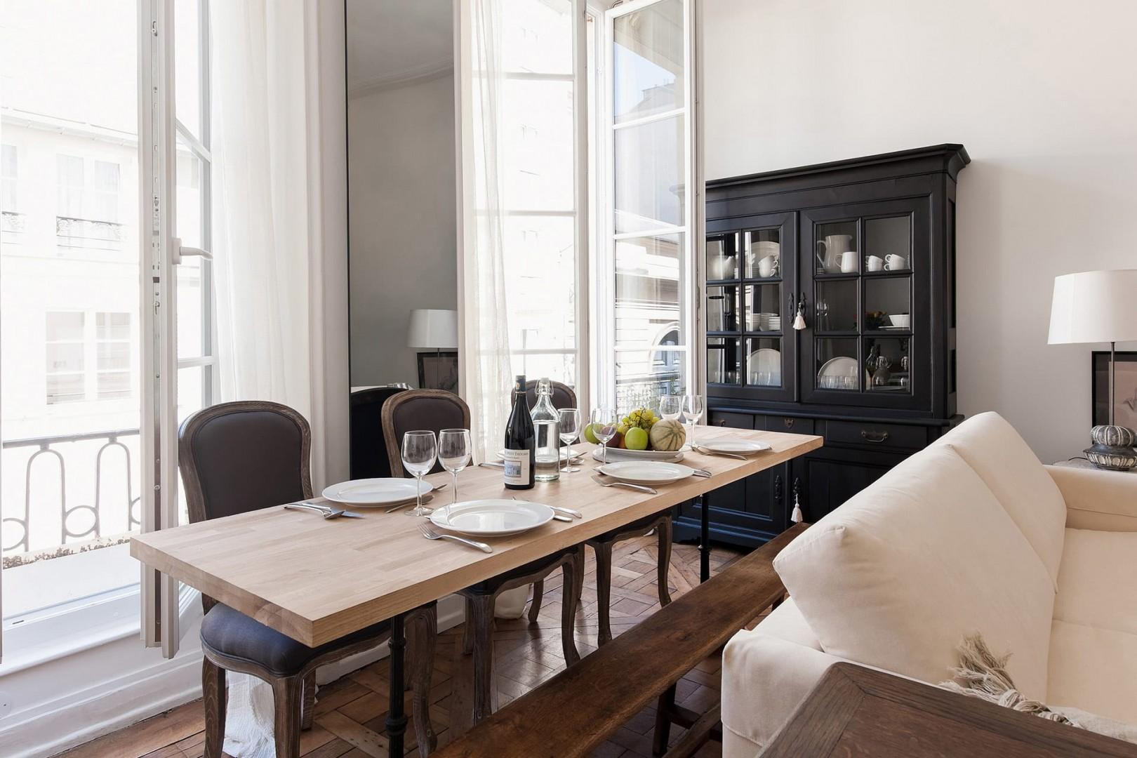The dining table has room for six guests, perfect for dinner parties!