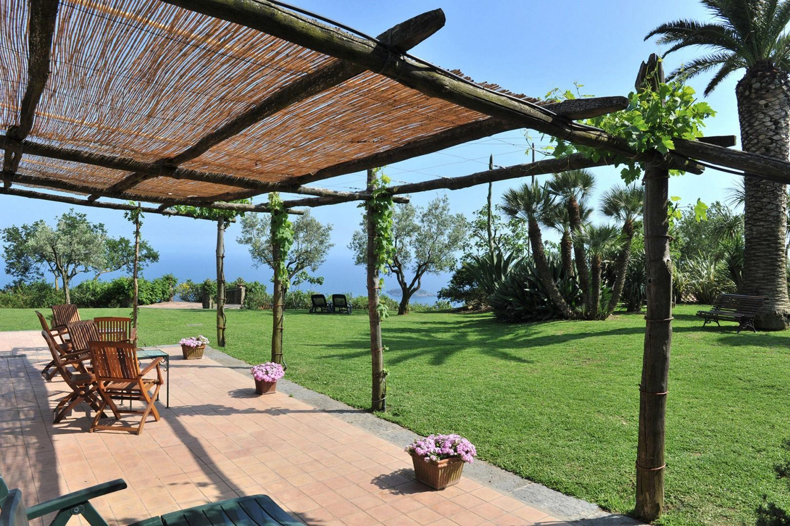 Villa Serena offers many places to relax or congregate like this large covered terrace in front.