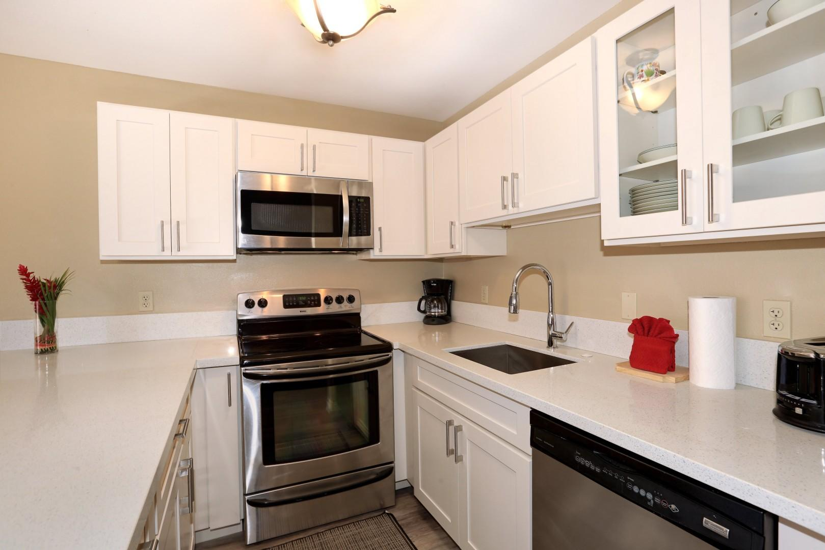 Full kitchen amenities including stainless steal range, microwave, dishwasher and refridgerator -min