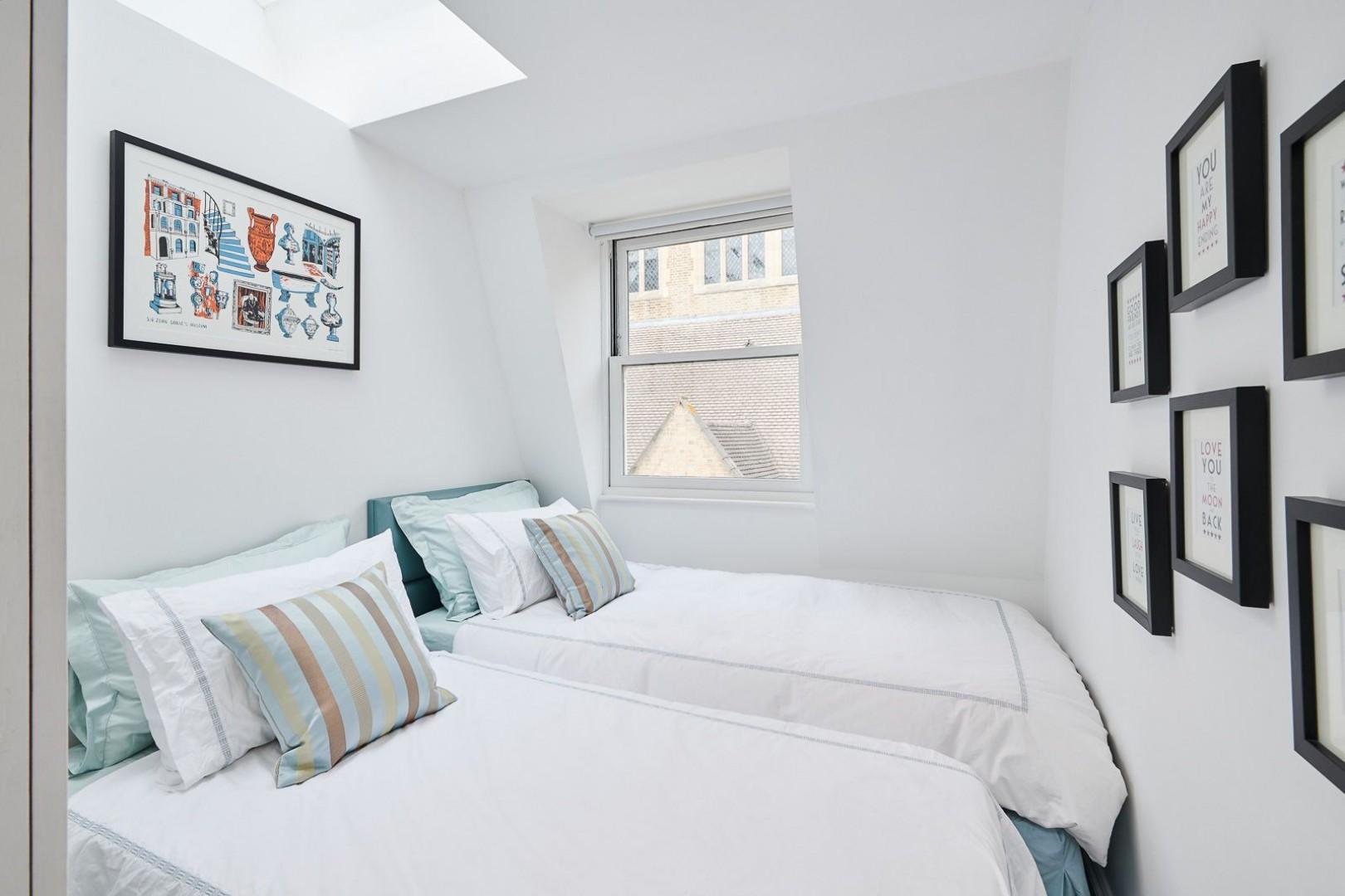 Top-floor third bedroom with skylight