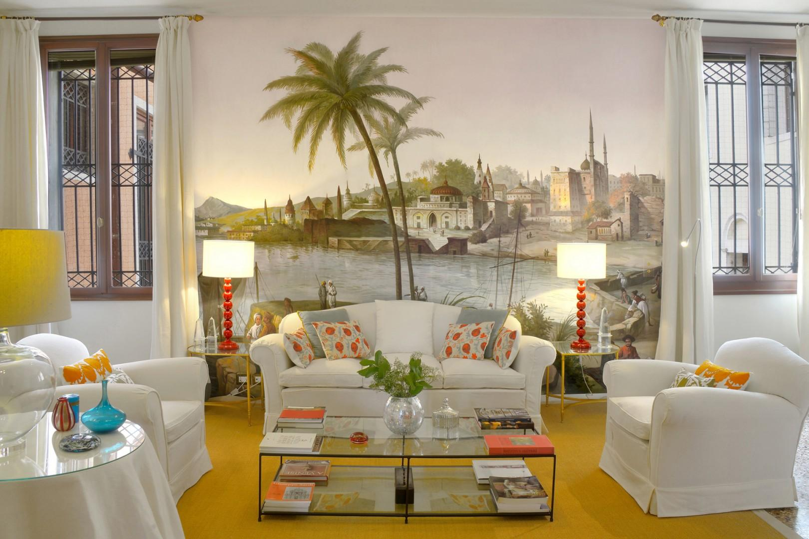 A lovely fresco in the living room sets the tone for the apartment.