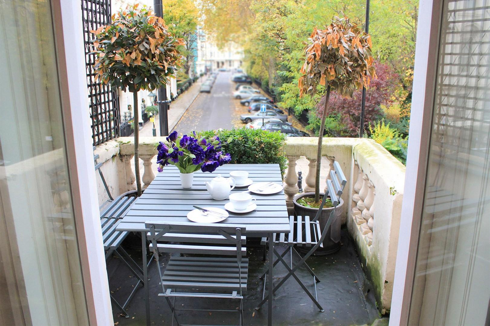Charming balcony with garden views located off living room