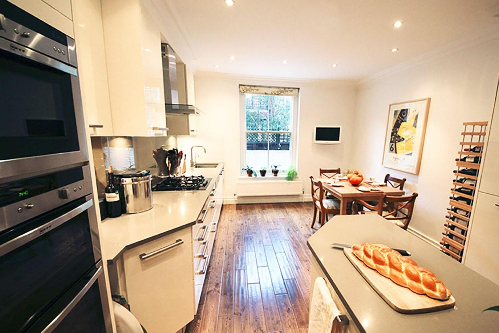 Gorgeous kitchen with large window and dining area
