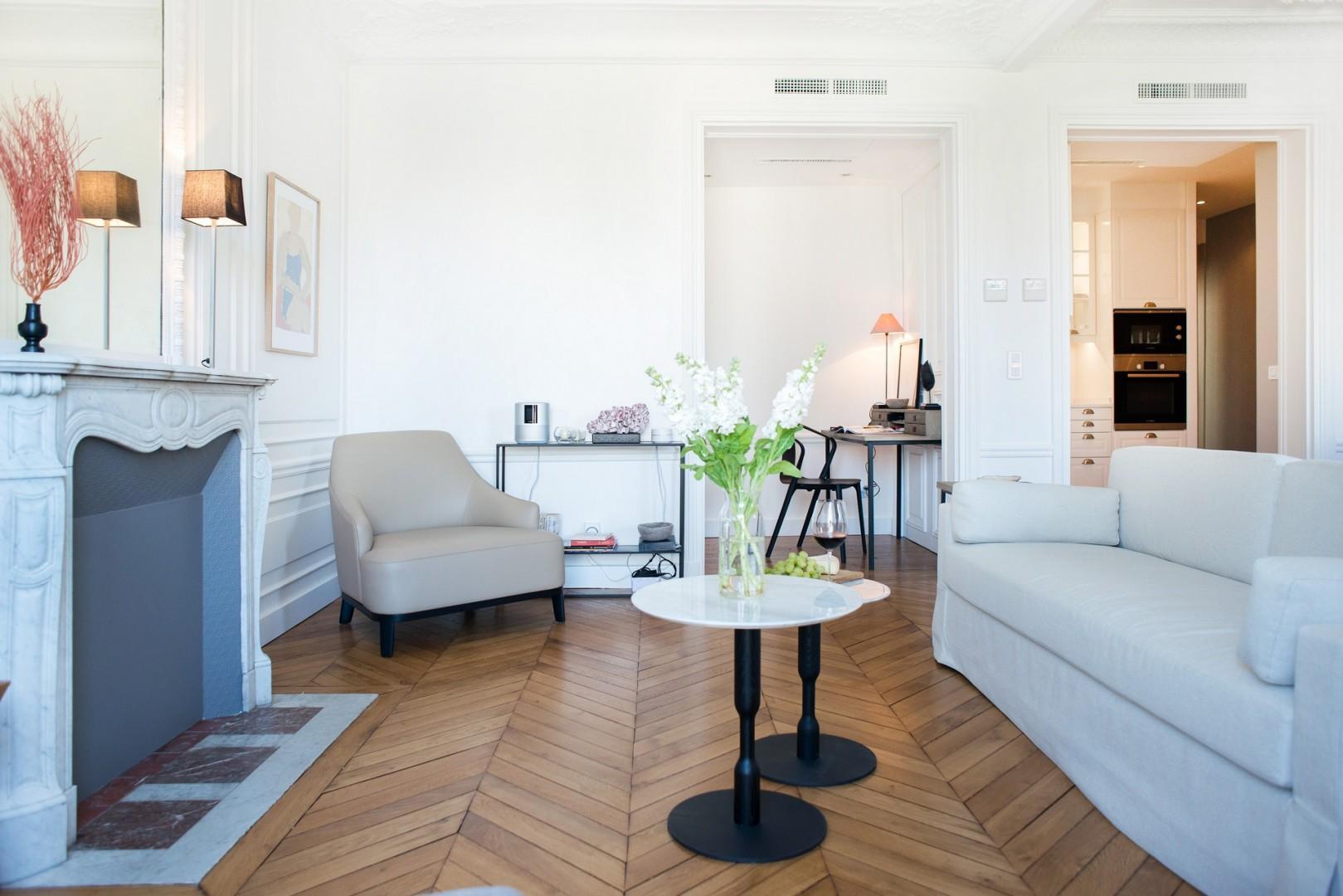 Enjoy the original fireplace mantle and modern design furniture.