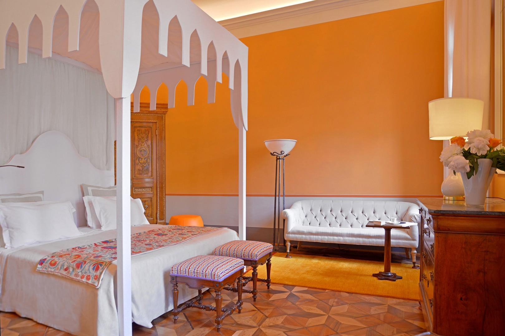 Large bedroom with window overlooking the classic Venetian campo.