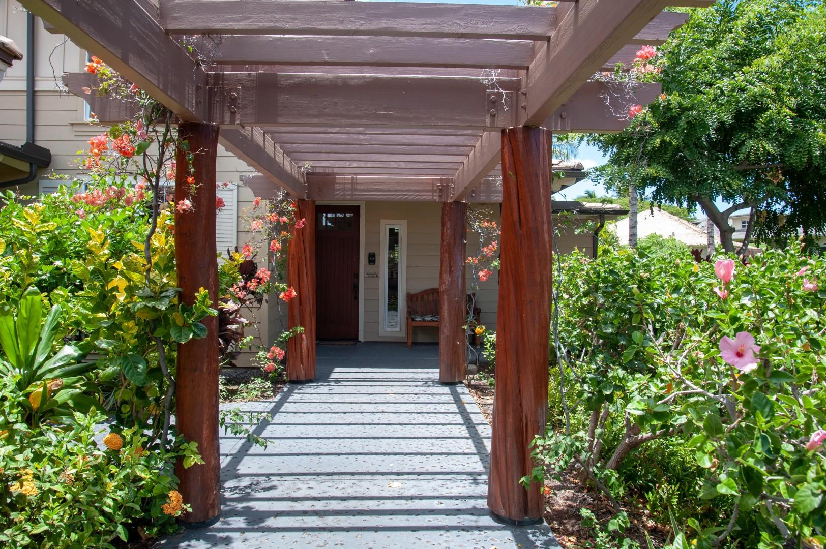 Trellised Entrance Surrounded w/ Tropical Flowers