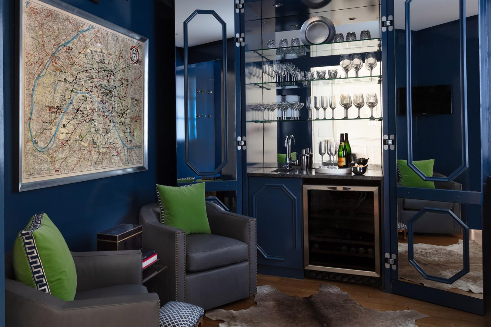 The den with a built-in bar is perfect for entertaining!