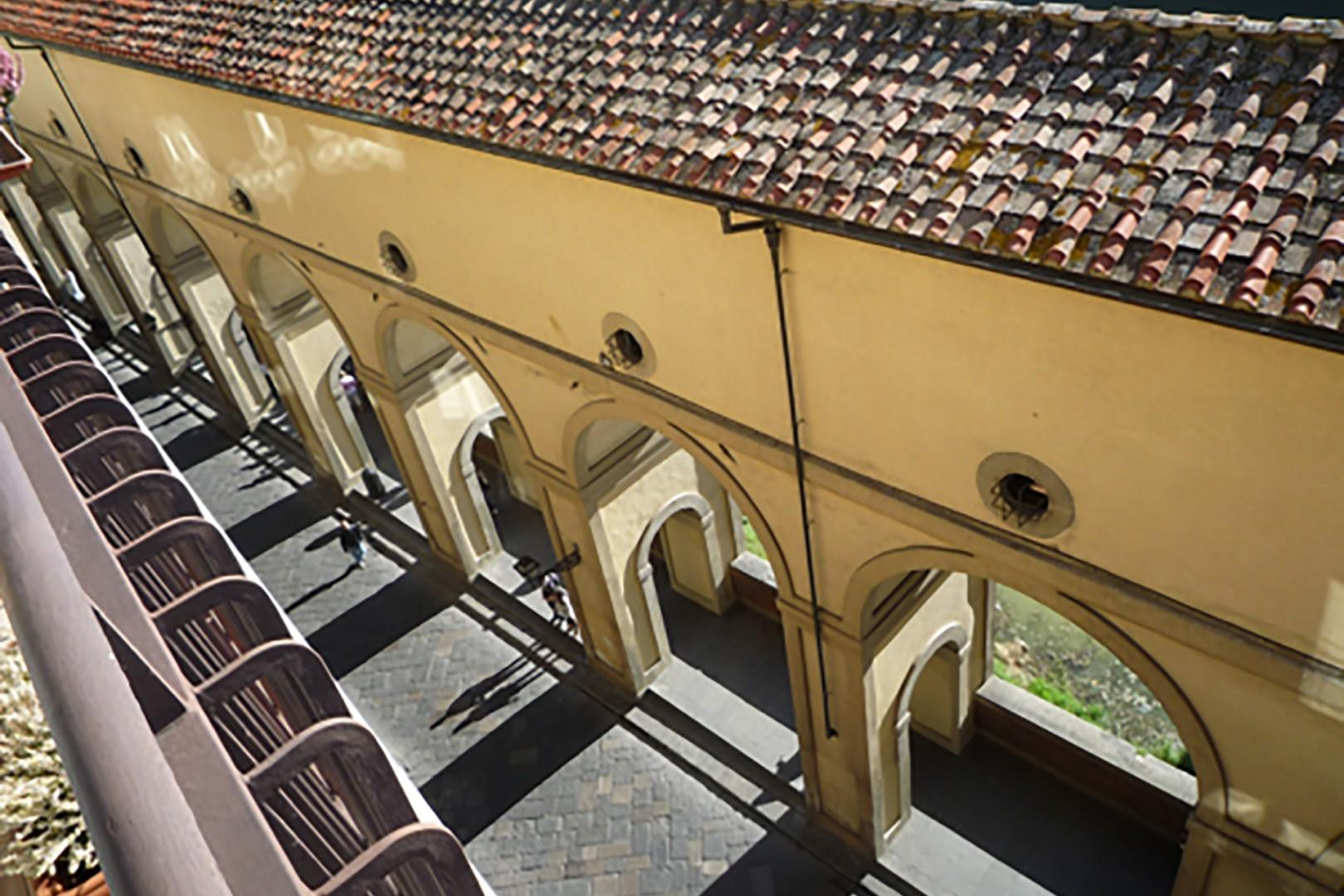 From the terrace you can see the arched walkway that runs along the Arno river.