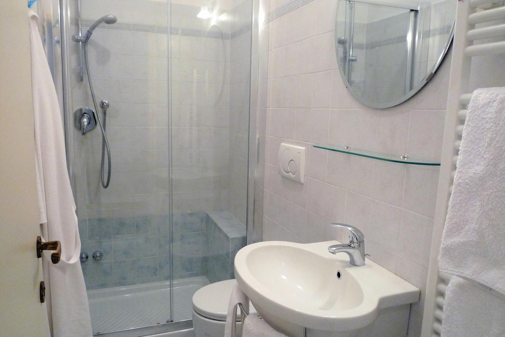 Bathroom 2 also has a fully enclosed shower.