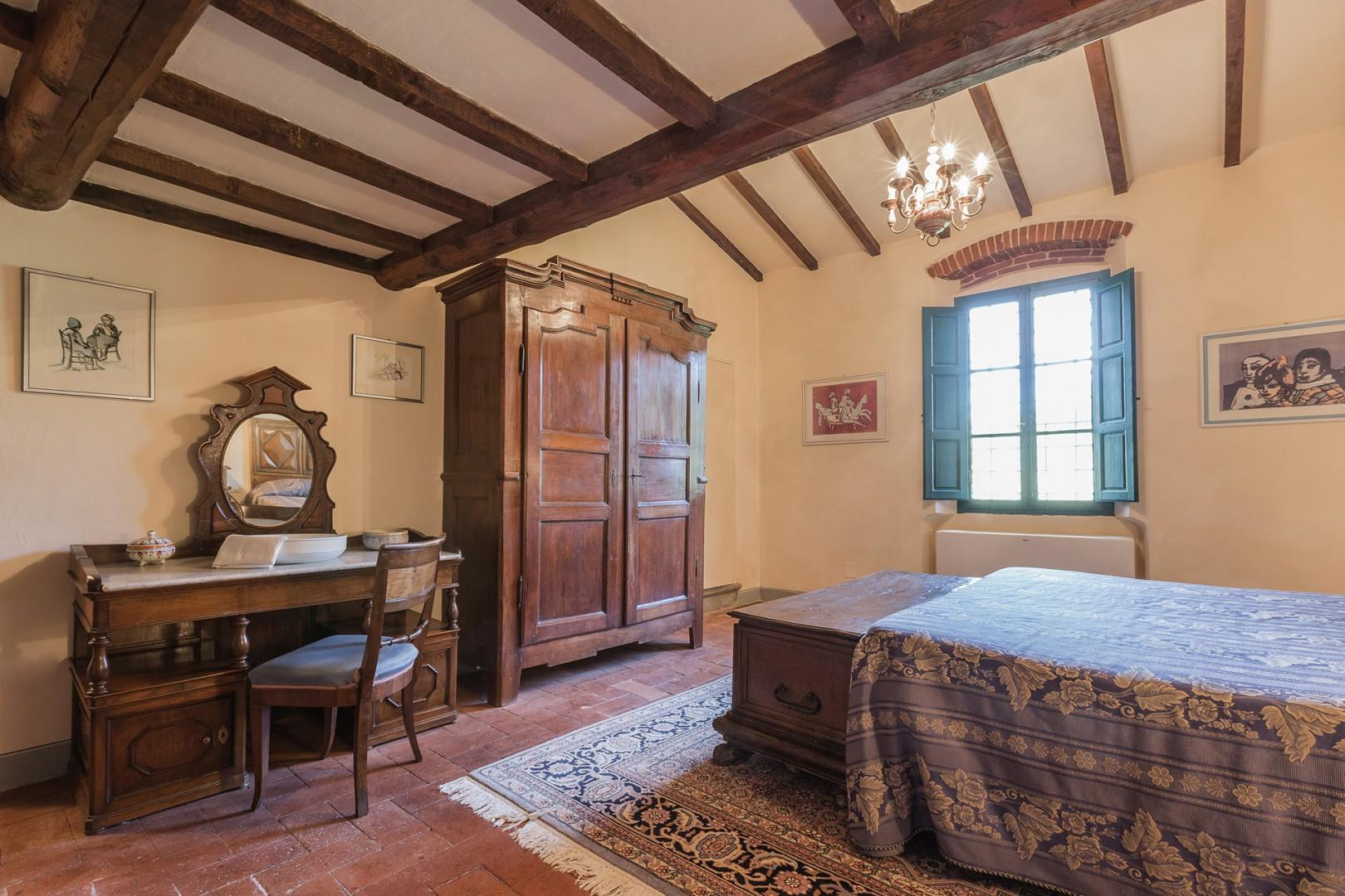 Nice antiques in bedroom 4. The en suite bath features a Jacuzzi shower.