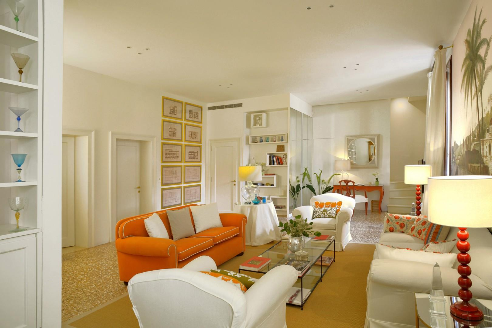 Sophisticated furnishings with pretty color highlights in the living room.