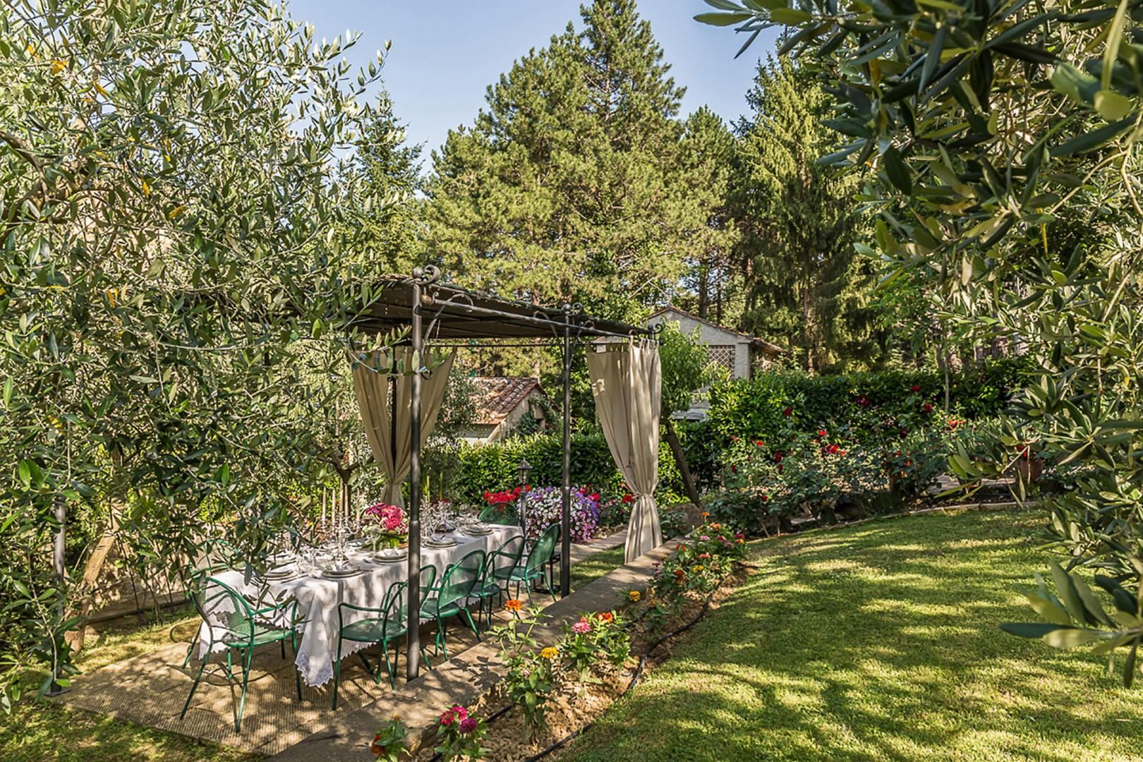 The dreamy pergola for dining or relaxing is just outside the villa.