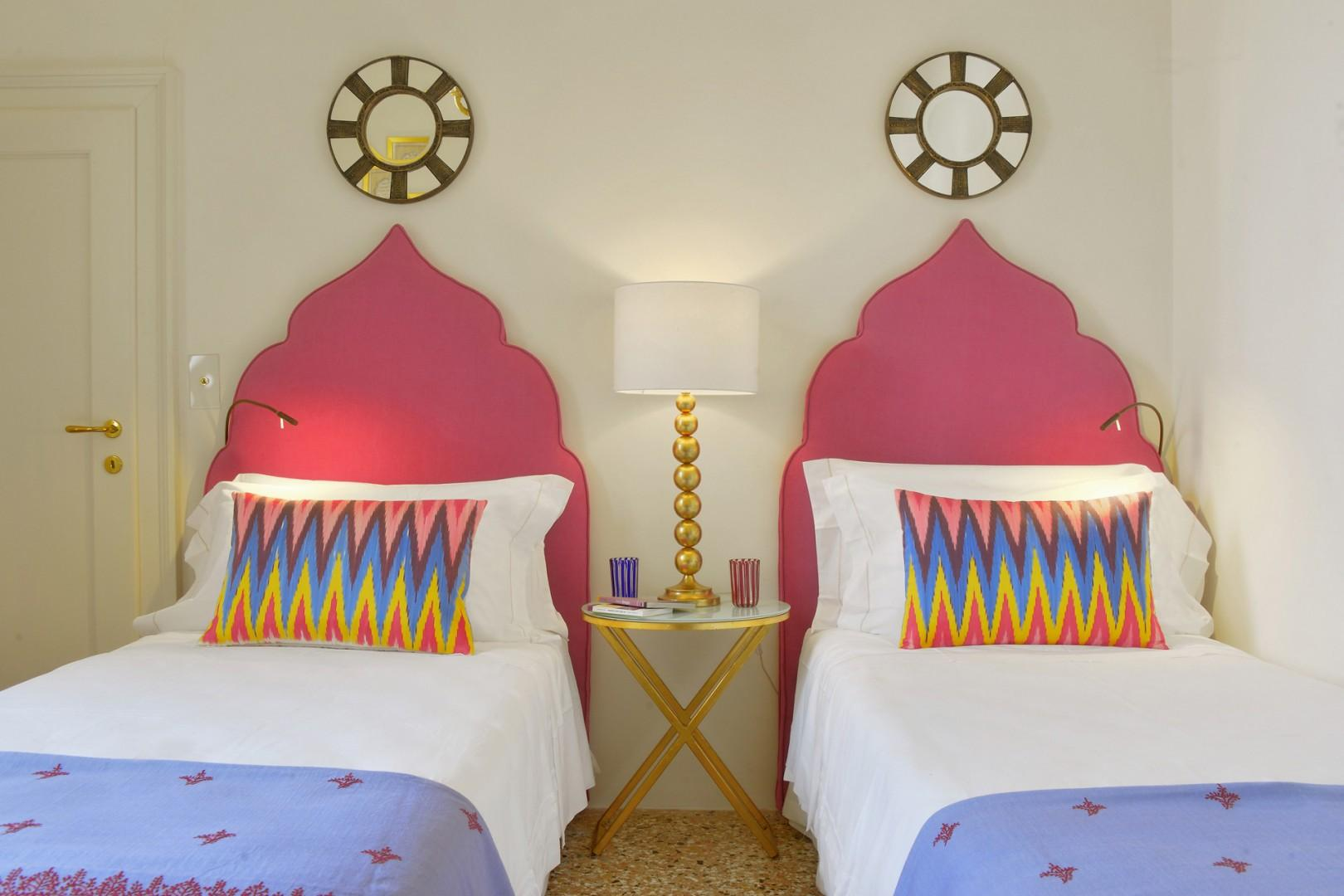 The headboards of bedroom 2 remind us of the byzantine design of Venetian windows.