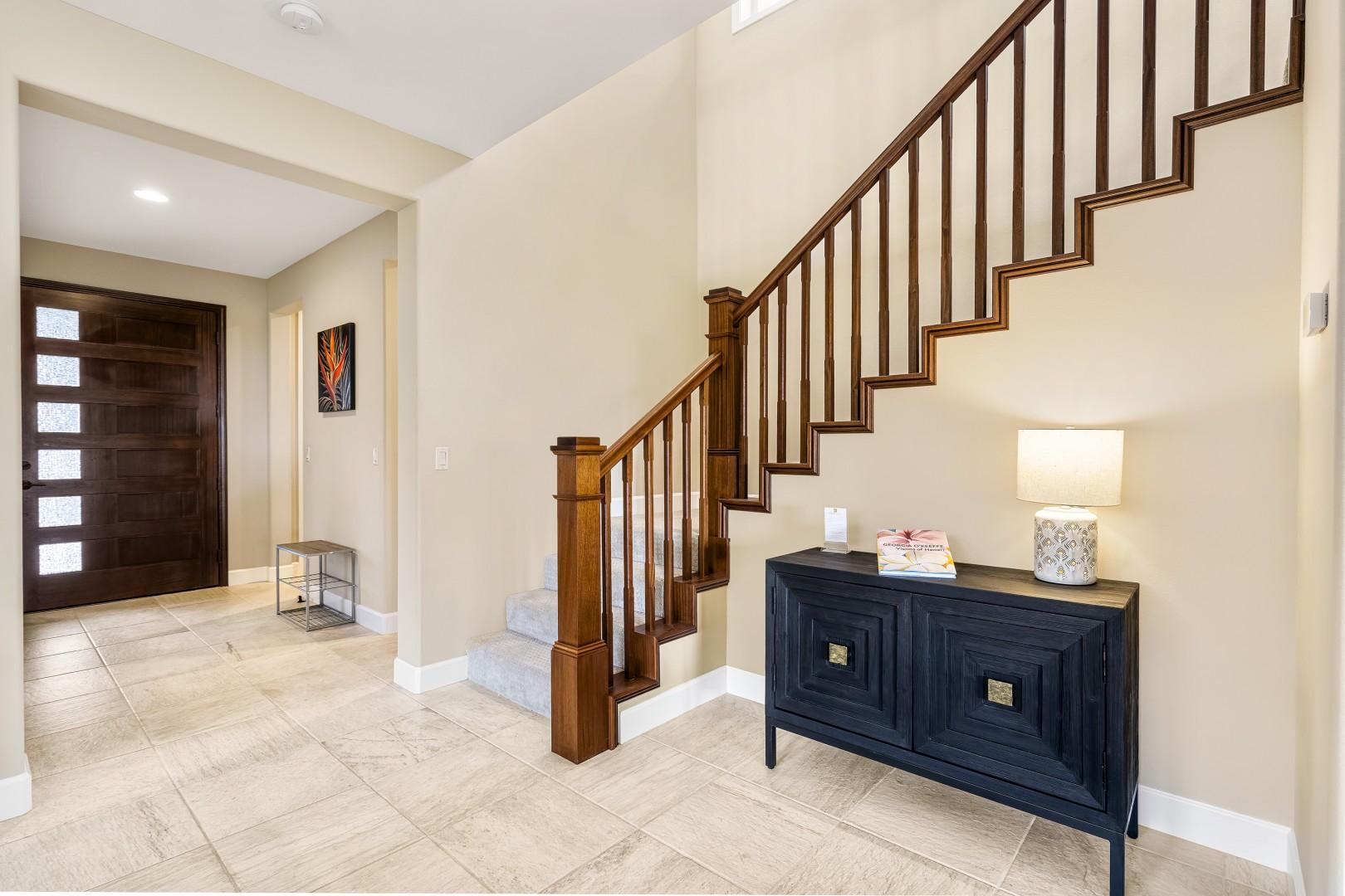 Stairs leading to the Upstairs Master bedroom, guest bedroom with 2 Twins, and upstairs Living room