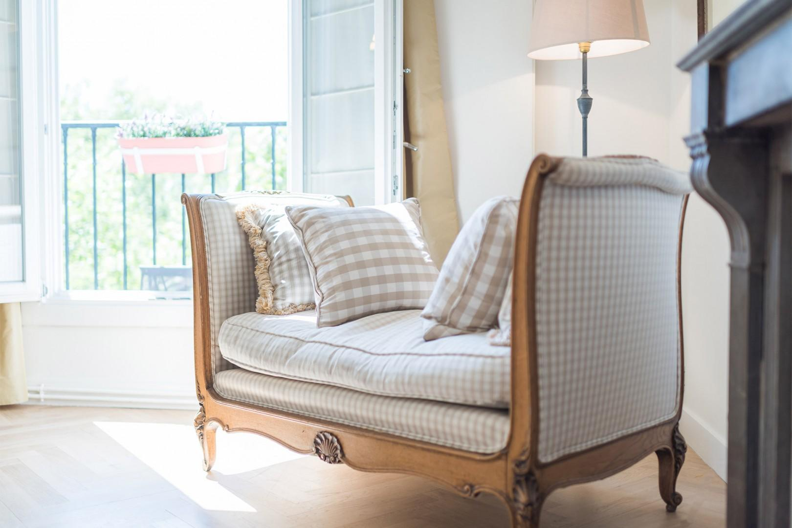 Curl up in the charming antique love seat in the living room.