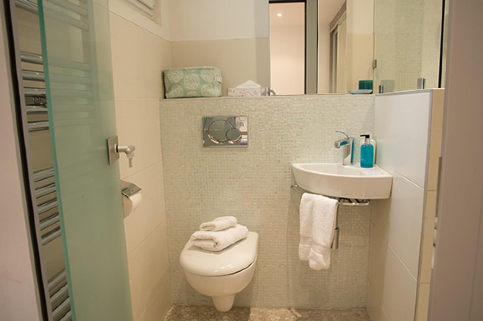 The en suite bathroom to bedroom 1 comes with a shower, toilet and sink.