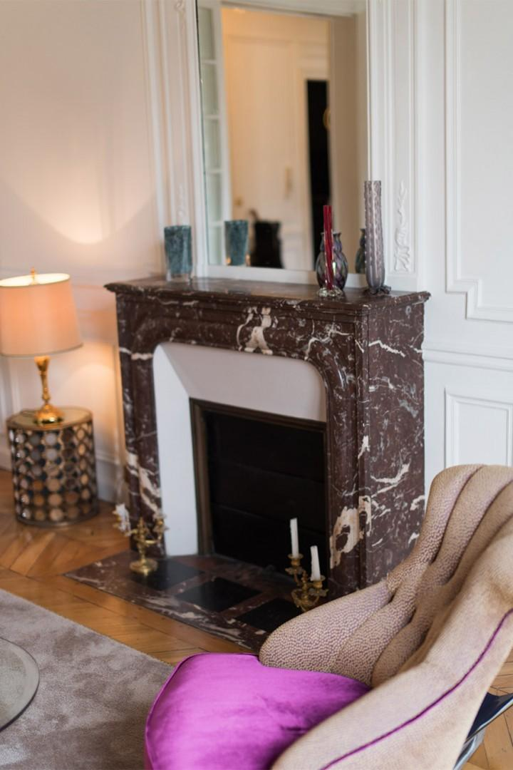 The marble fireplace provides a focal point to the living room.