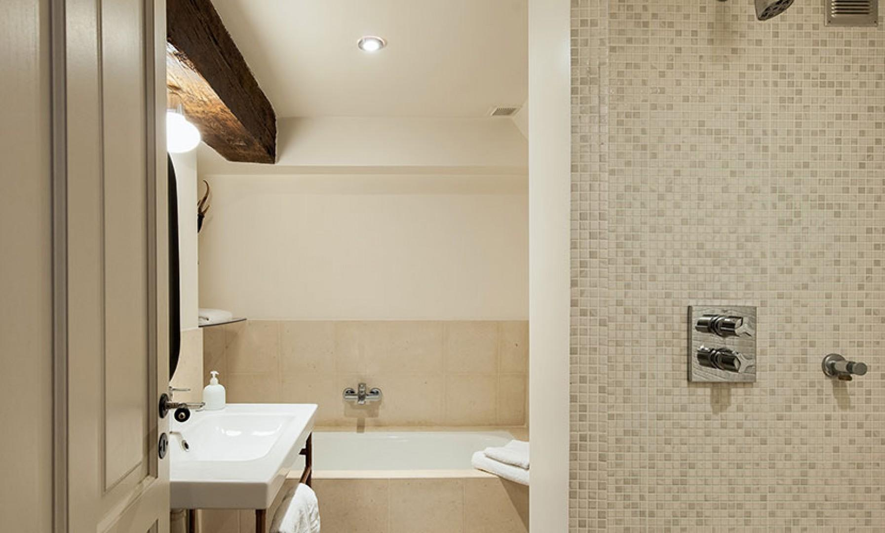 Modern conveniences mix with original features in the bathroom.