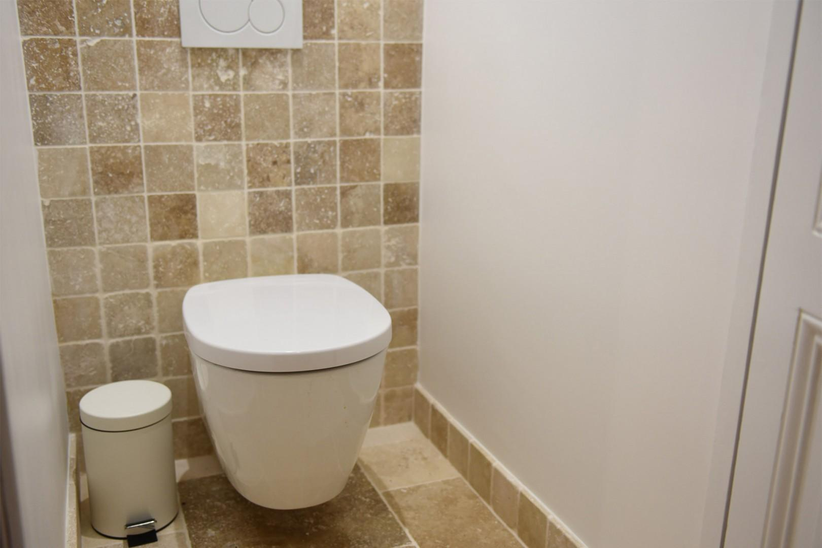 There is a separate half bath with toilet.