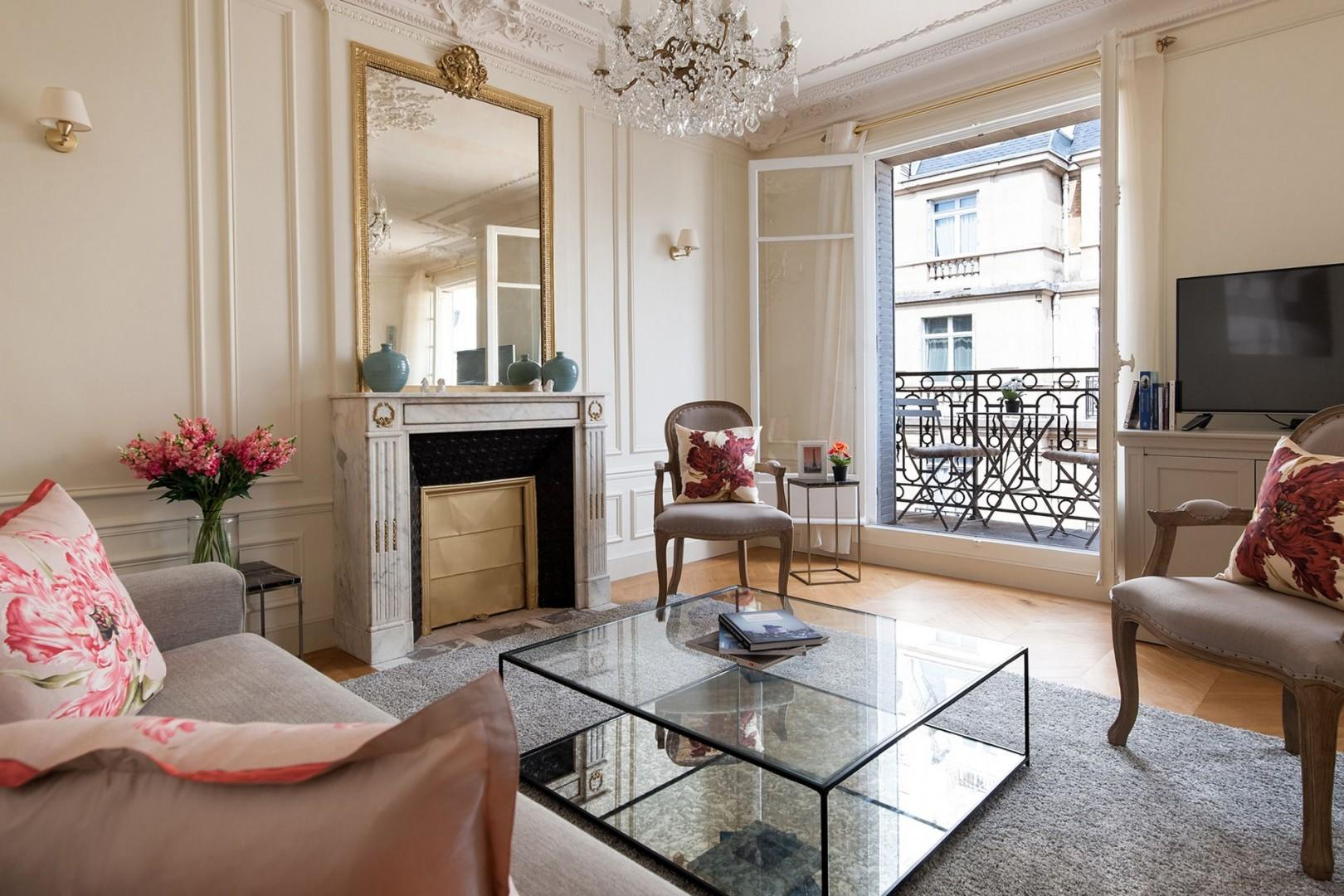 Large French windows let in lots of light into the living room.