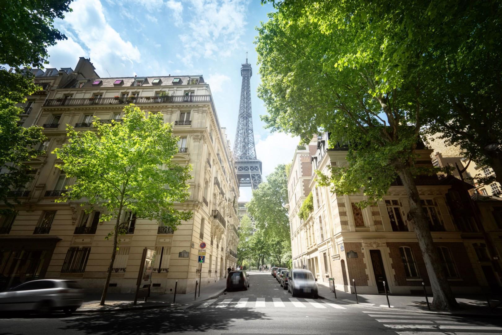 Eiffel Tower between buildings