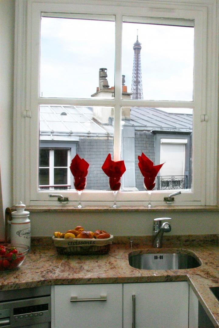 Watch the Eiffel Tower as you prepare meals.