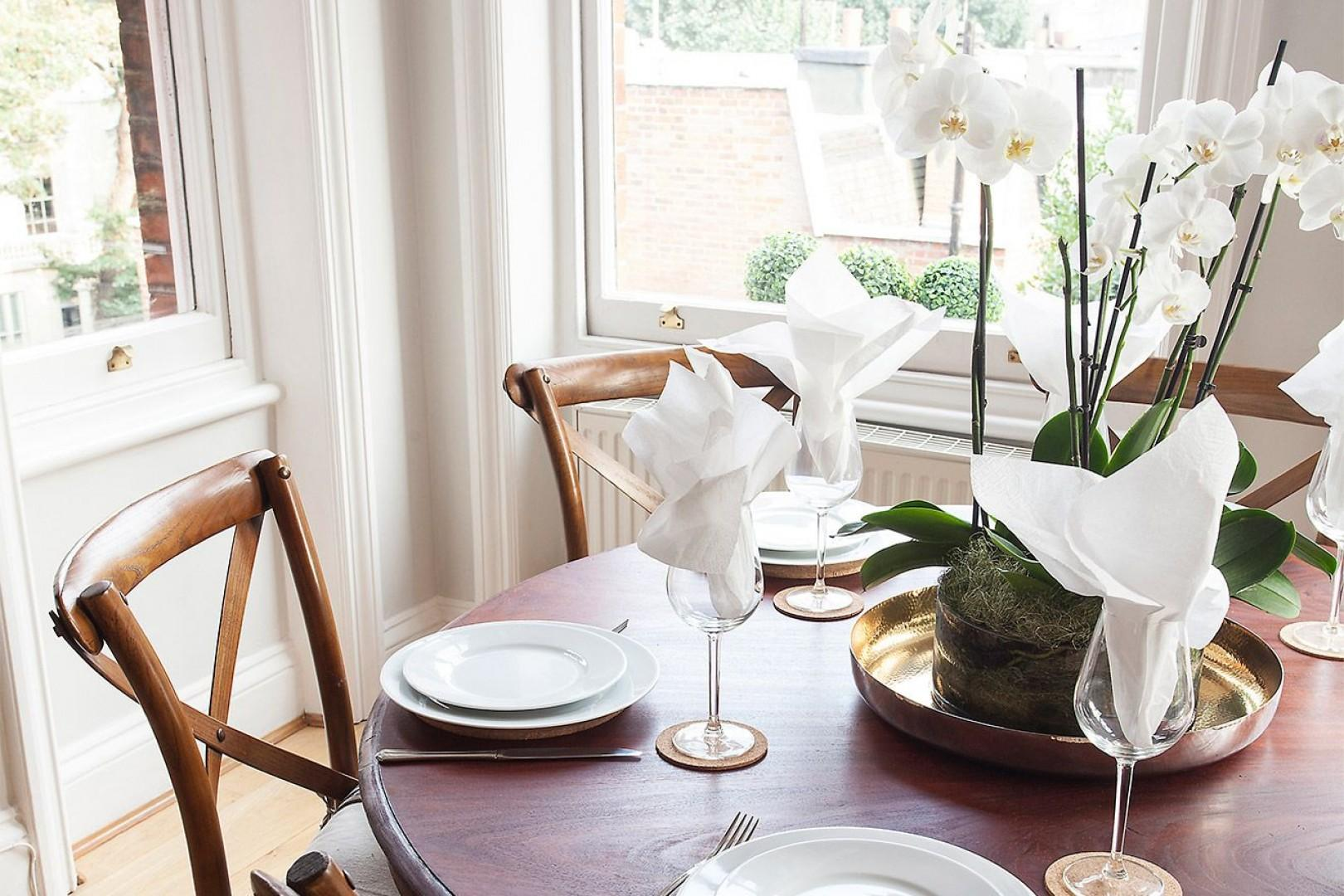 Set the table for a romantic dinner at home