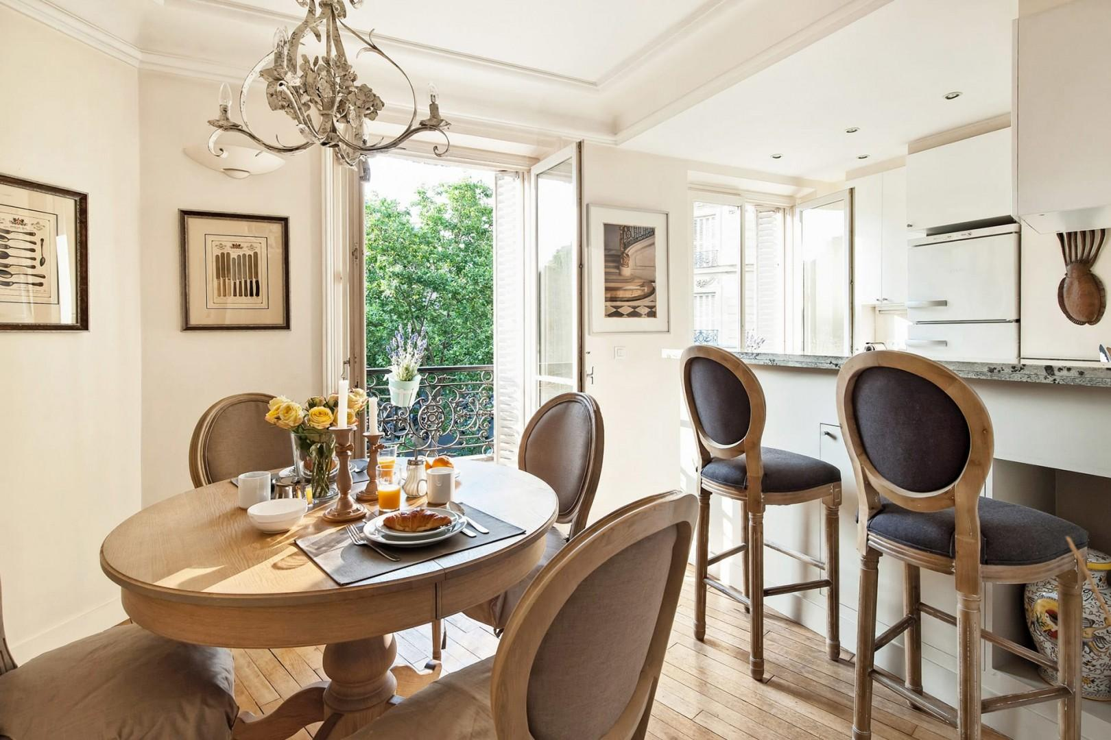 The dining table is conveniently located next to the kitchen.