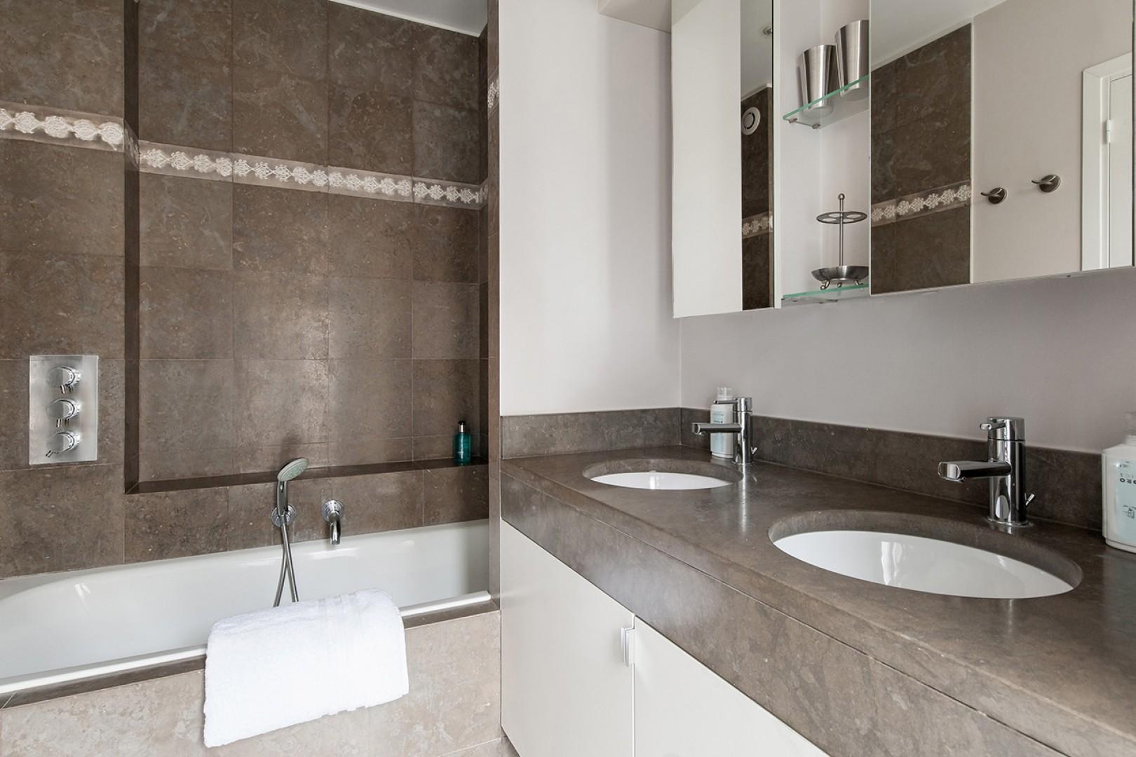 Rich marble in the large en suite bathroom