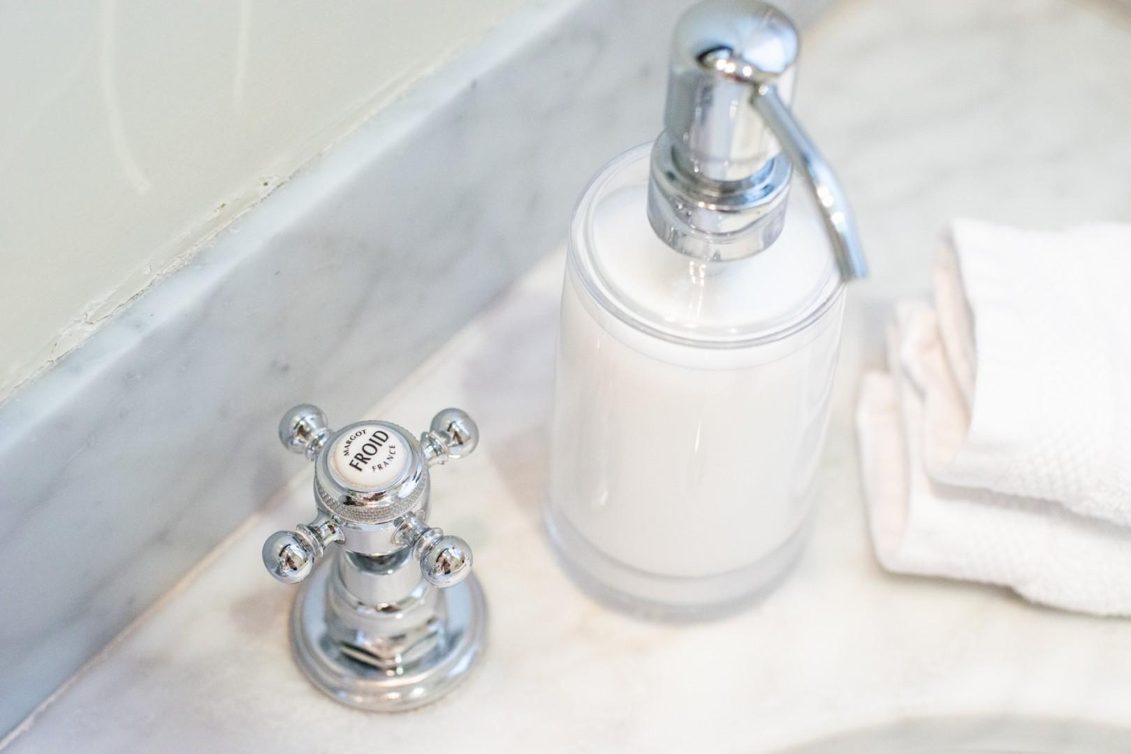 Enjoy the elegant amenities in the en suite bathroom.
