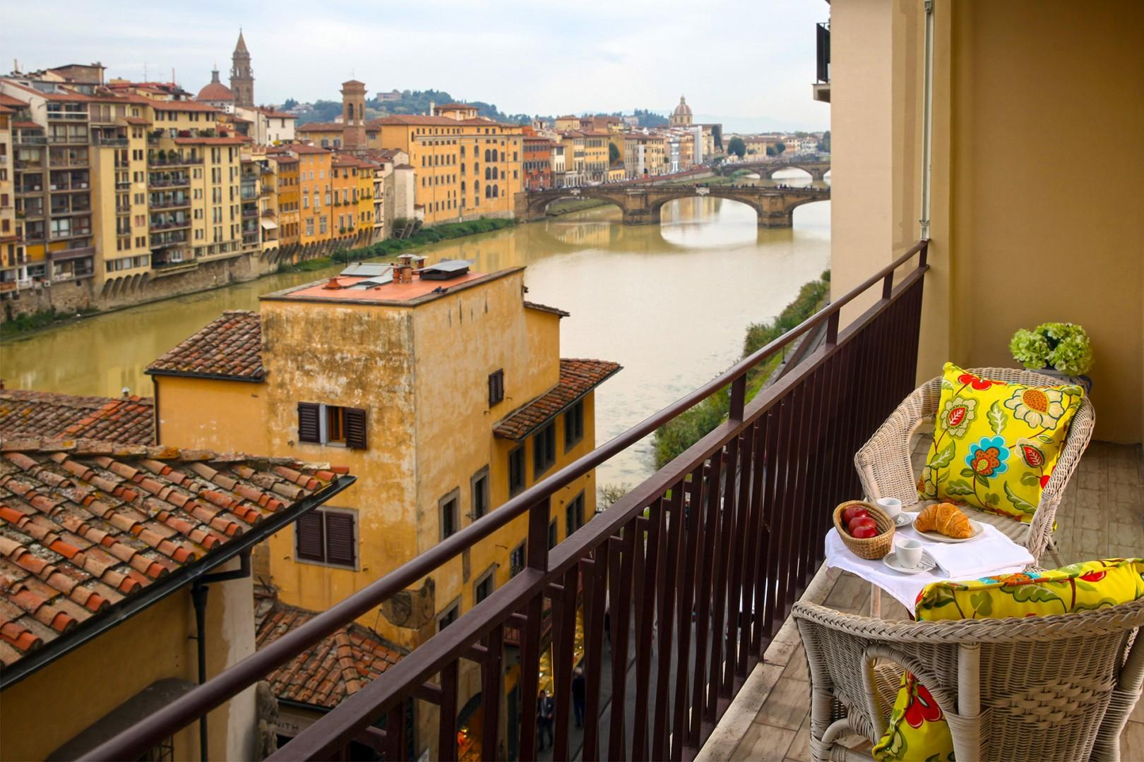Step out onto the terrace and drink in the views. The narrow terrace has a table and two chairs.