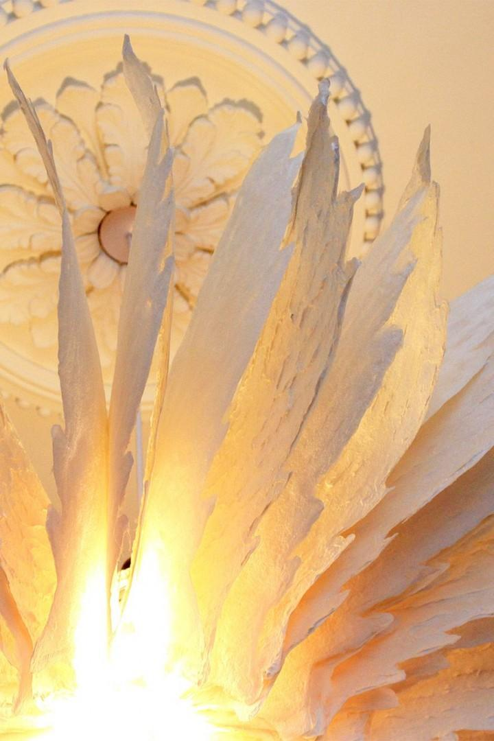 Delicate light fitting in the bedroom