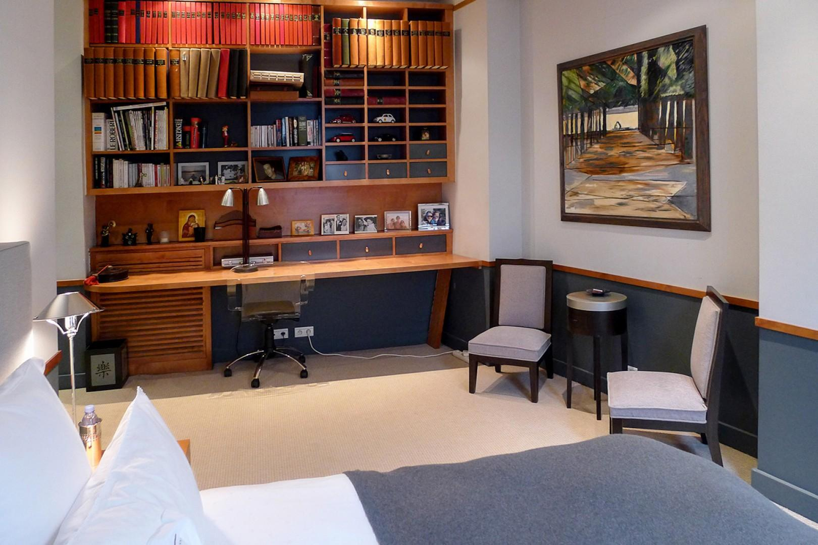 Bedroom 3 features a built-in desk and study area.