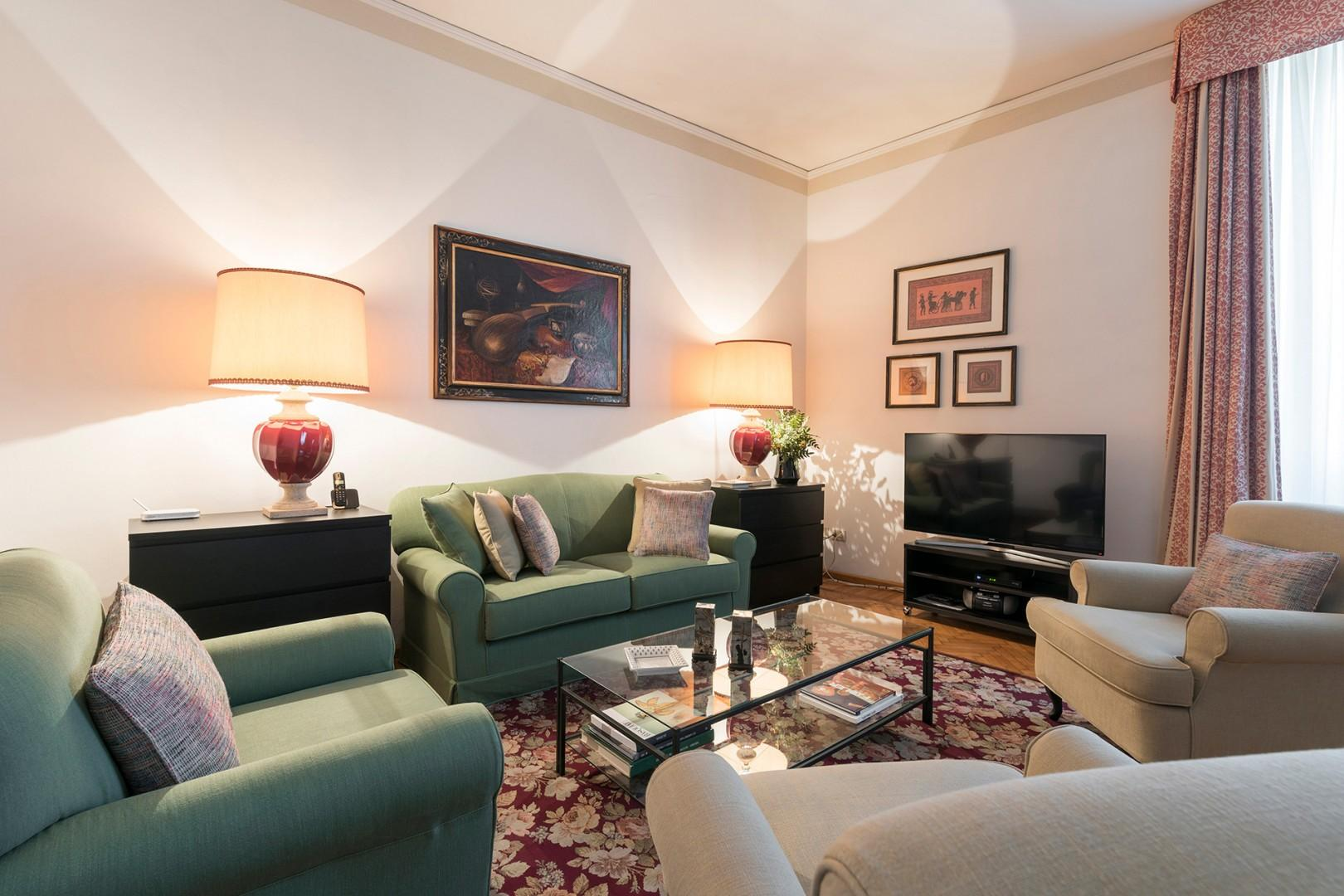 Comfortable seating with flat screen TV which receives several English language news channels.