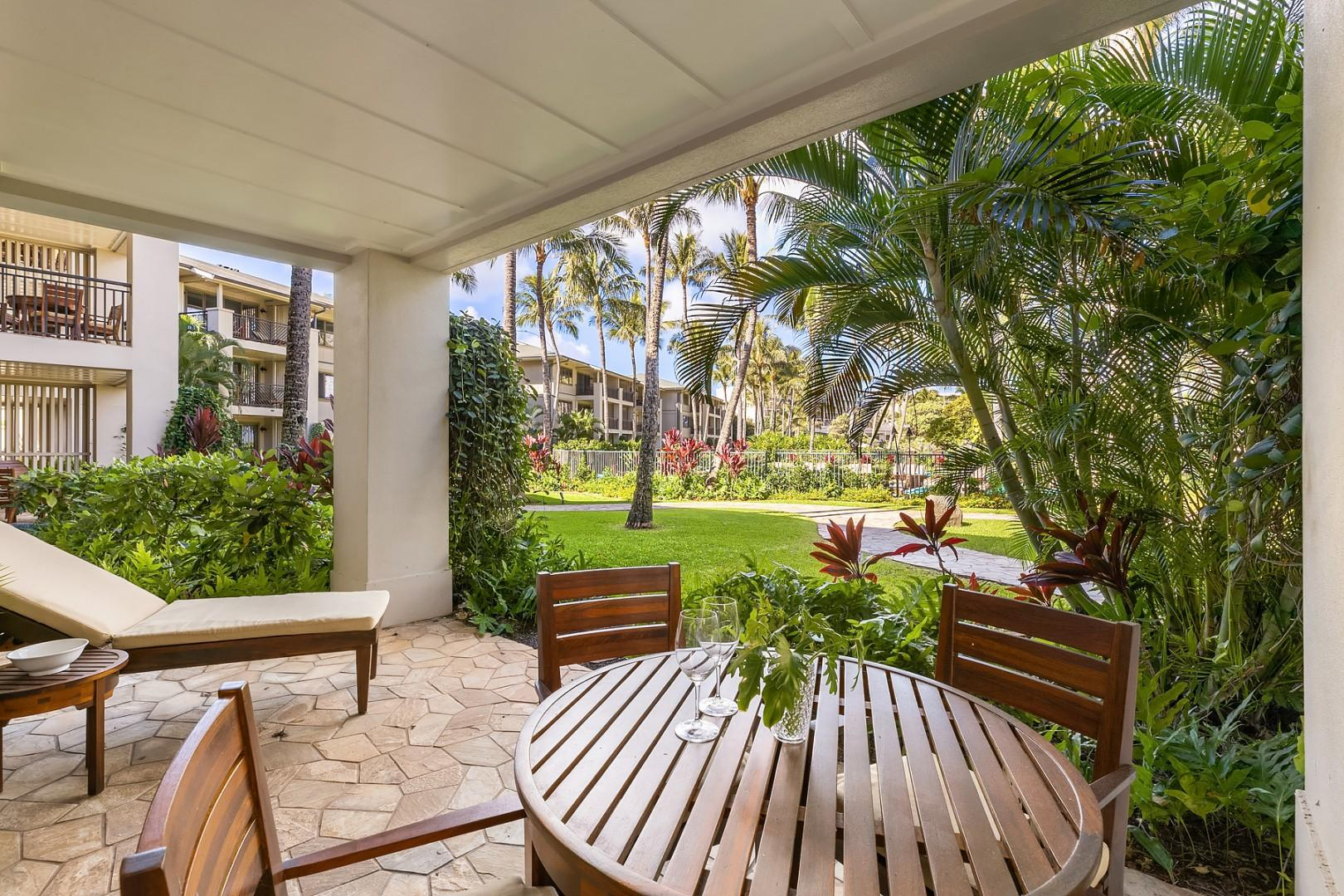 Ground floor lanai with beautifully landscaped garden views, and easy access to the pool and beach lagoon in front.