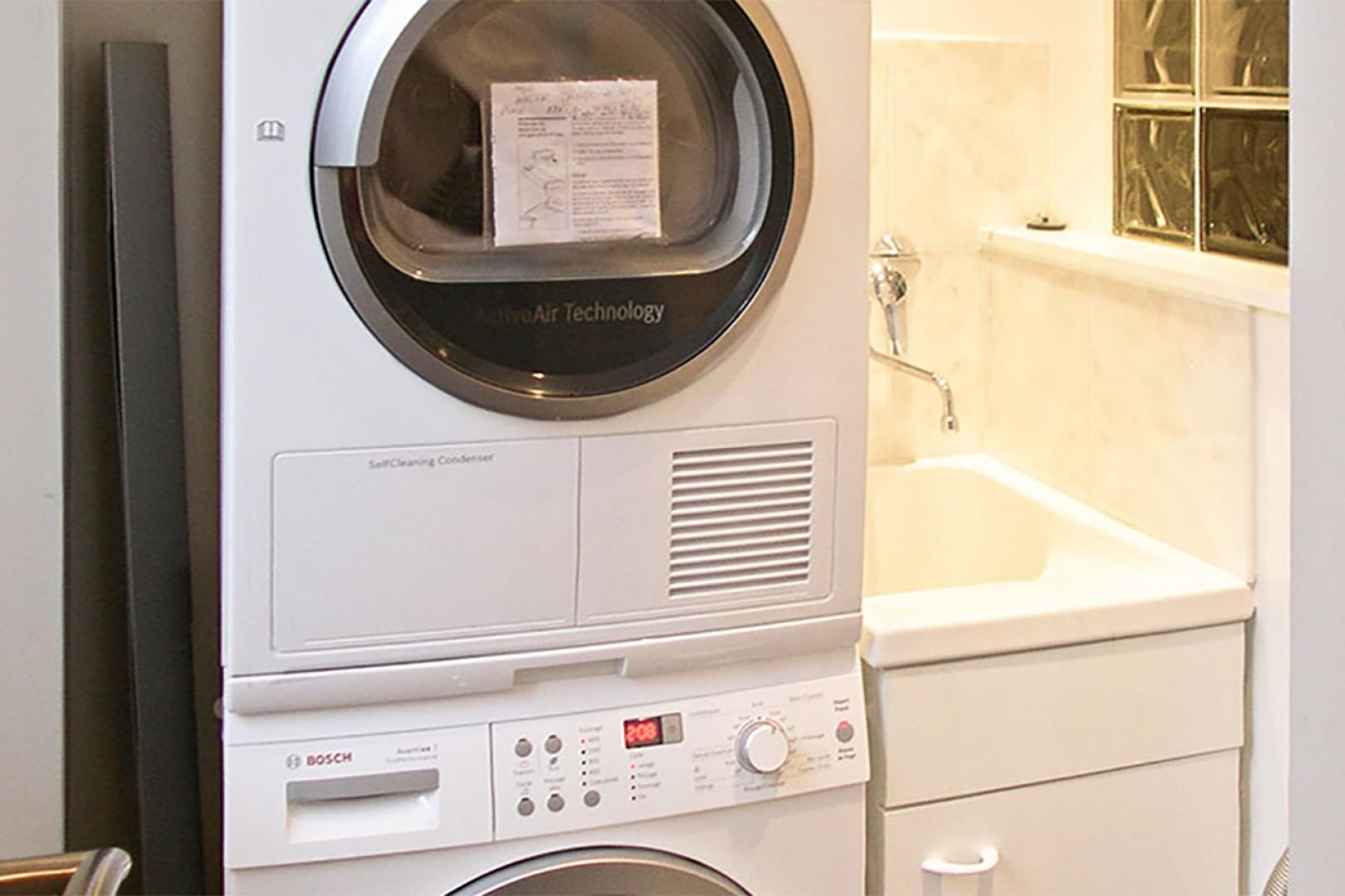 For your convenience, there is a laundry room with washer, dryer and sink.