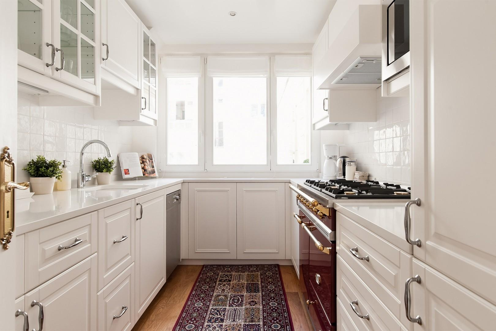 The kitchen comes with plenty of storage cabinets.