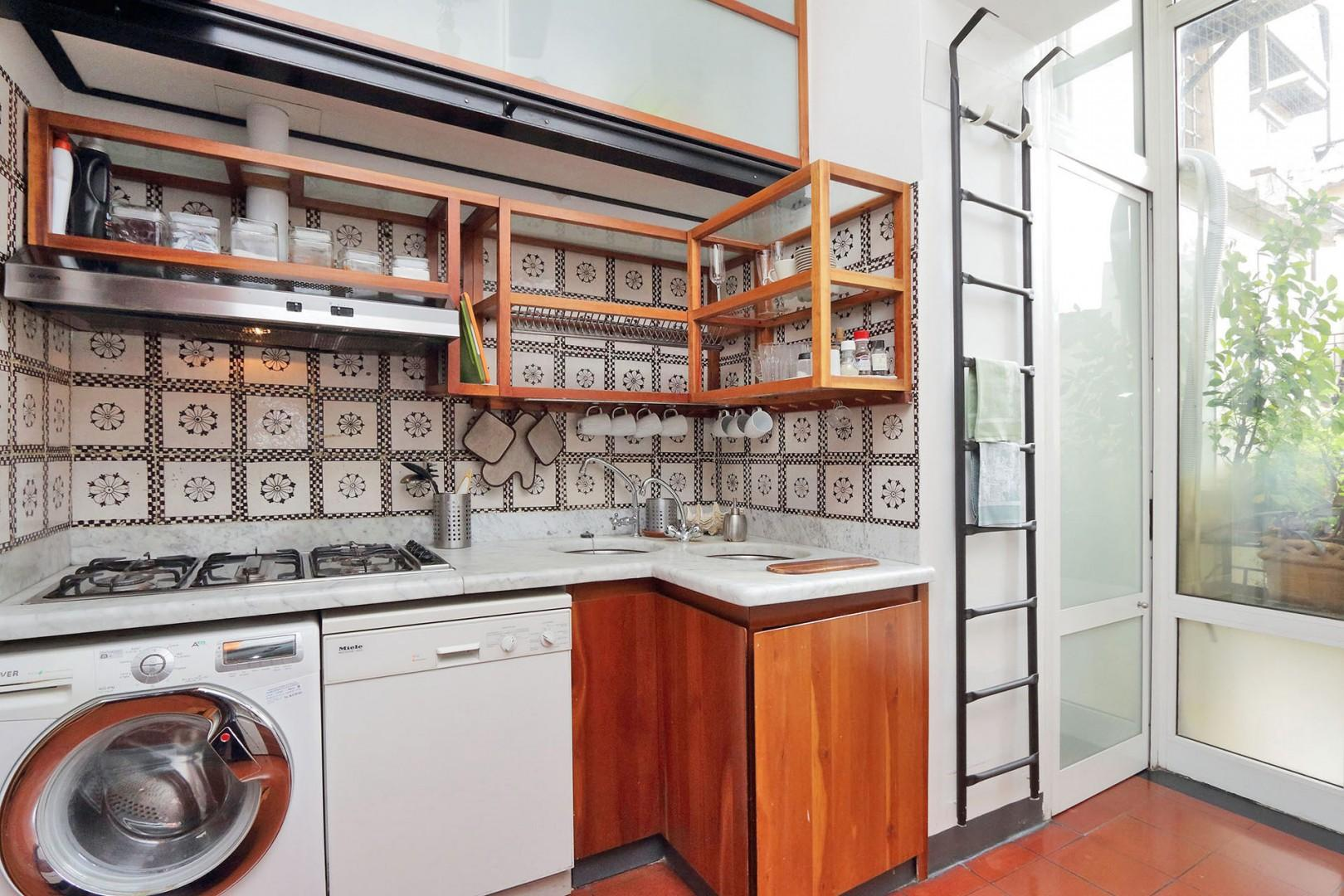 Kitchen is well-stocked. Marble countertops and all essential kitchen appliances.