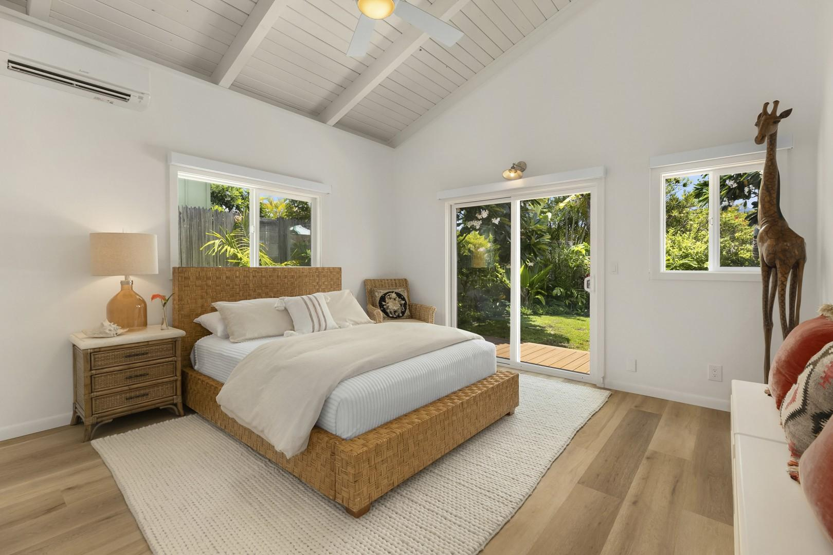 Master bedroom with private access  to main lanai and garden area, Split A/C, and access too Outdoor Shower.