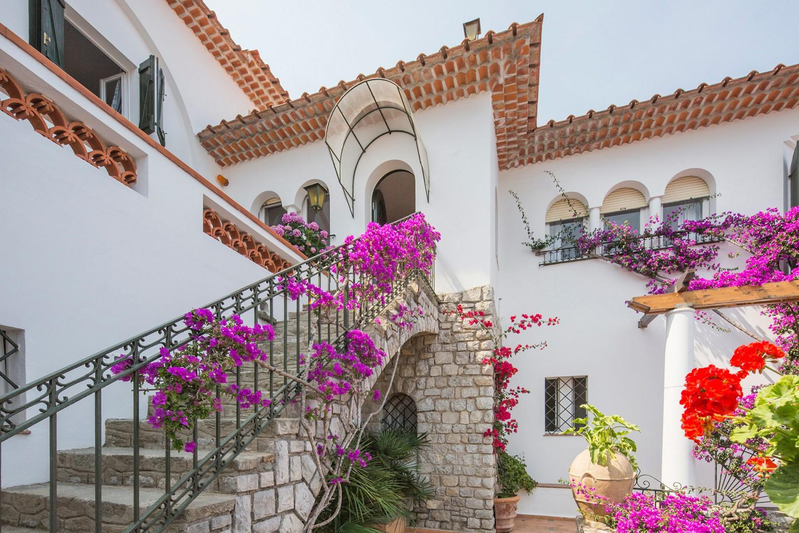 Entrance of Villa Sole, the three windows to the right of the main door are in the living room.