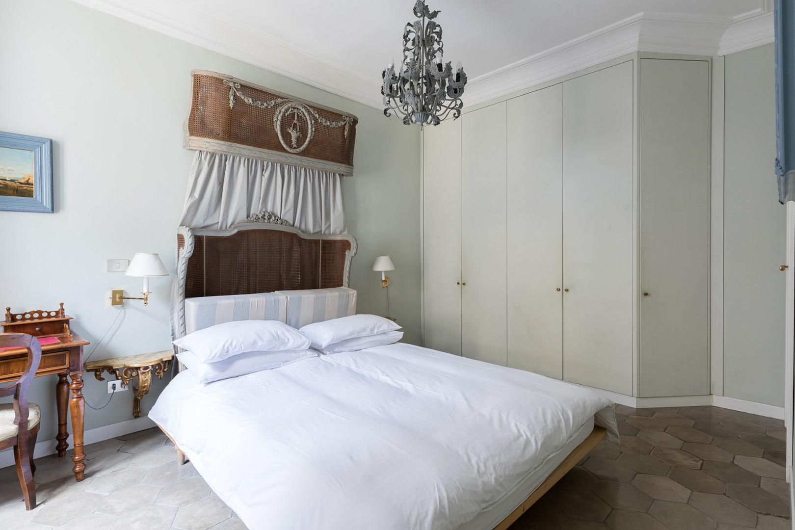 Beautiful antique wicker bedstead in bedroom 1 with an en suite bathroom