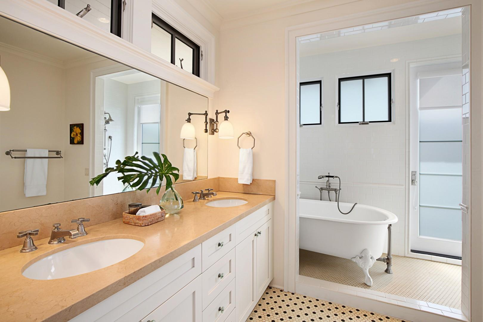 Master bathroom with clawfoot soaking tub and outdoor shower