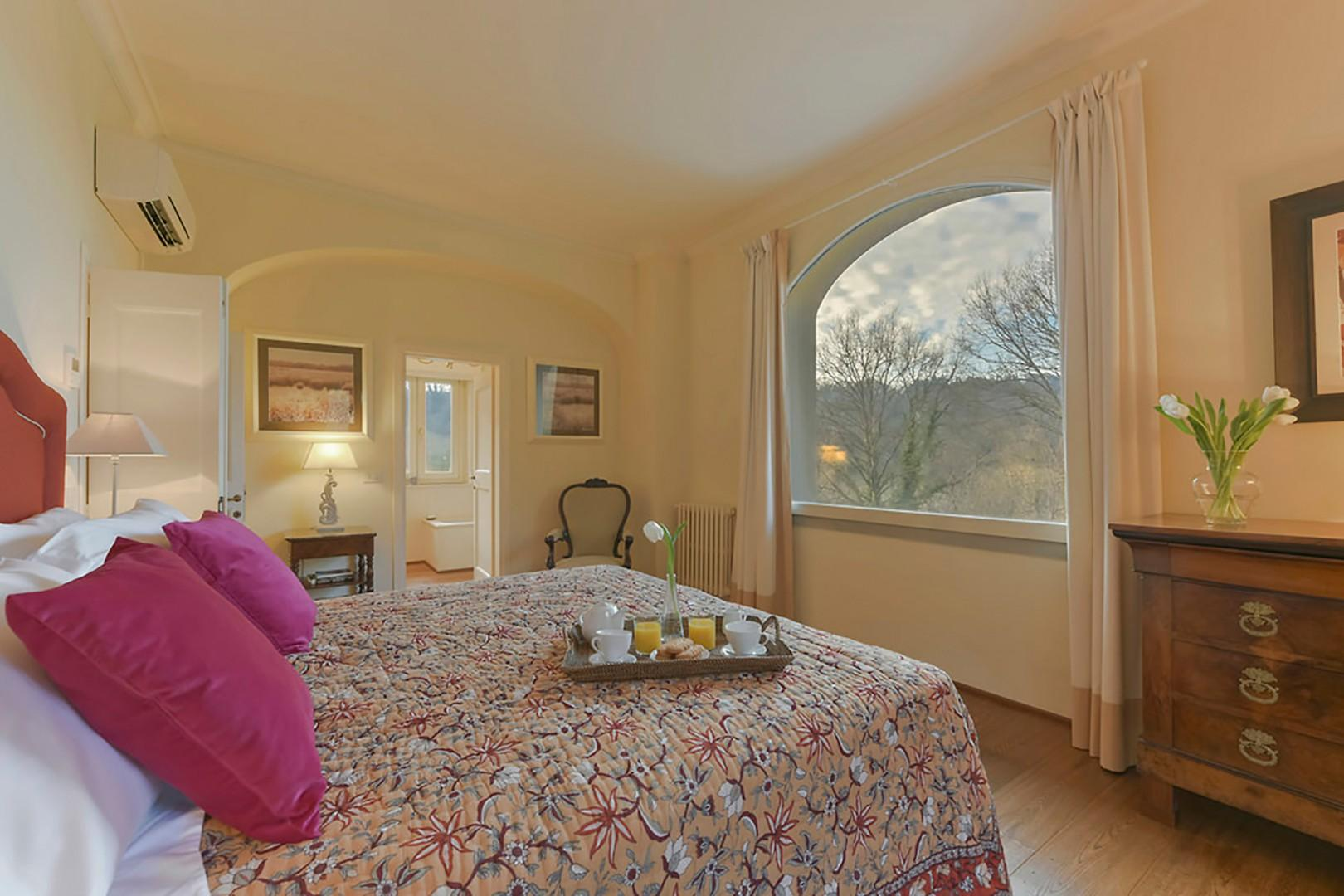 Bedroom 1 with large picture window overlooking the forest.
